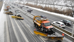A line of snow plows clears the Gardiner Expressway in Toronto on Tuesday, Feb.12, 2019 after a winter storm hit the region. A huge winter storm is sweeping across Ontario and bringing everything from freezing rain to high winds with it. THE CANADIAN PRESS/Frank Gunn