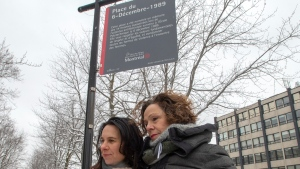 Montreal Mayor Valerie Plante and NDG-Cote des Neiges borough Mayor Sue Montgomery attend the inauguration of a new sign at Dec. 6th Park commemorating the 30th anniversary of the 1989 Ecole Polytechnique attack where a lone gunman killed 14 female students Thursday, December 5, 2019 in Montreal. The new sign now mentions that it was an attack against women and feminists. THE CANADIAN PRESS/Ryan Remiorz