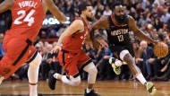 Houston Rockets guard James Harden (13) drives past Toronto Raptors guard Fred VanVleet (23) as Raptors guard Norman Powell (24) moves in during second half NBA action in Toronto on Thursday, Dec.5, 2019. THE CANADIAN PRESS/Nathan Denette
