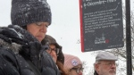 People attend the inauguration of a new sign at Dec. 6th Park commemorating the 30th anniversary of the 1989 Ecole Polytechnique attack where a lone gunman killed 14 female students Thursday, December 5, 2019 in Montreal. The new sign now mentions that it was an attack against women and feminists.THE CANADIAN PRESS/Ryan Remiorz