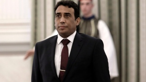 In this Tuesday, Dec. 18, 2018 file photo Mohamed Younis A.B. Menfi Ambassador of Libya in Greece attends a ceremony at the Presidential Palace in Athens. Greece's foreign minister says on Friday, Dec. 6, 2019, his country is expelling the Libyan ambassador in the latest escalation of a dispute over a controversial deal between Libya's UN-supported government and Turkey on maritime boundaries in the Mediterranean. (John Liakos/InTime News via AP, File)