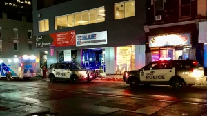 Police vehicles are shown at the scene of a stabbing investigation on Yonge Street south of Wellesley Street early Friday morning. (Mike Nguyen)
