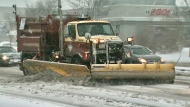 A plow can be seen clearing the streets on Friday morning. The city was expected to get about five centimetres of snow by late morning. (Craig Berry)