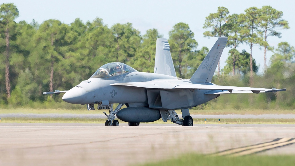 In this Sept. 12, 2018 photo, an F/A-18 Super Hornet aircraft from Naval Air Station Oceana taxis after landing at Naval Air Station Pensacola, Fla..(Gregg Pachkowski//Pensacola News Journal via AP)