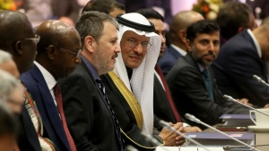 Prince Abdulaziz bin Salman Al-Saud, center, Minister of Energy of Saudi Arabia looks prior to the start of a meeting of the Organization of the Petroleum Exporting Countries, OPEC, at their headquarters in Vienna, Austria, Thursday, Dec. 5, 2019. (AP Photo/Ronald Zak)