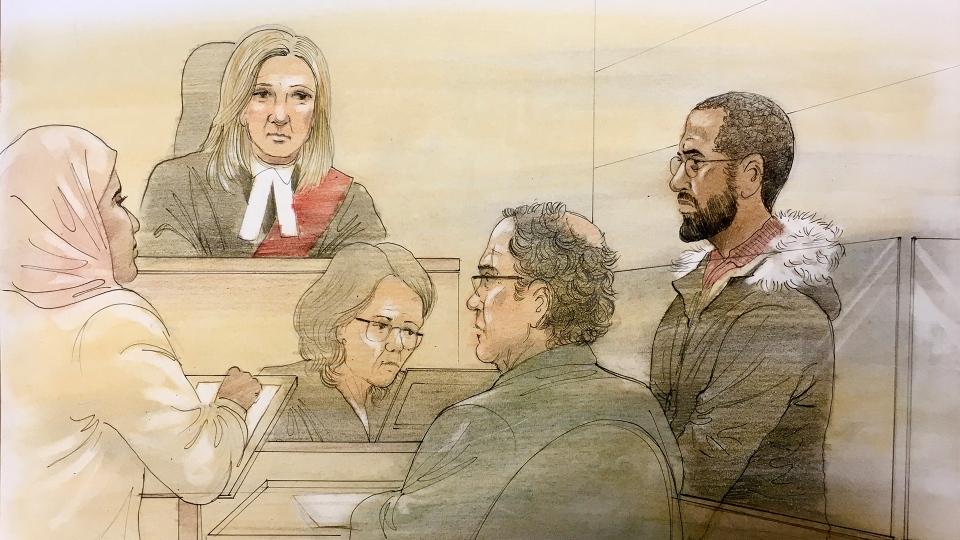 Ikar Mao, 22, (right) is seen in a Brampton courtroom on Dec. 06, 2019. (John Mantha)