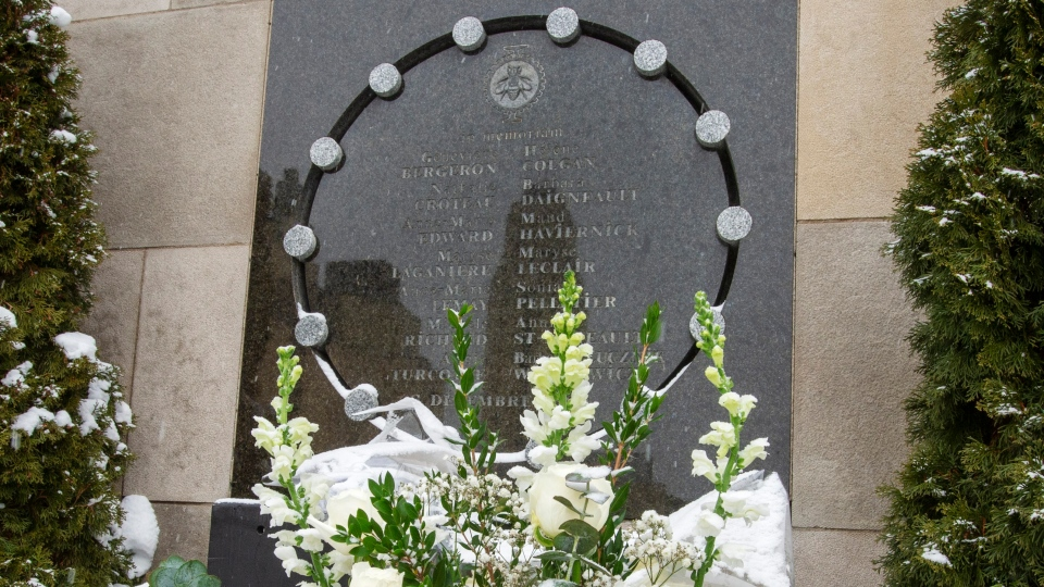 Flowers sit in front of the school's memorial plaque to mark the 30th anniversary of the 1989 Ecole Polytechnique attack where a lone gunman killed 14 female students Friday, December 6, 2019 in Montreal.THE CANADIAN PRESS/Ryan Remiorz