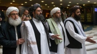 In this May 28, 2019, file photo, Mullah Abdul Ghani Baradar, the Taliban group's top political leader, second left, arrives with other members of the Taliban delegation for talks in Moscow, Russia. U.S. peace envoy Zalmay Khalilzad held on Saturday, Dec. 7, 2019 the first official talks with Afghanistan's Taliban since last September when President Donald Trump declared a near-certain peace deal with the insurgents dead. (AP Photo/Alexander Zemlianichenko, File)