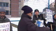 Displaced tenants and ACORN Toronto members are shown holding a protest outside 235 Gosford Boulevard on Dec. 7.