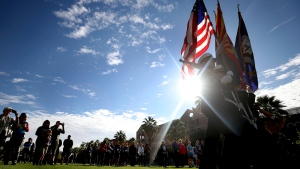 The University of Arizona Navy ROTC color guard present the colors during ceremonies on the school's mall commemorating the USS Arizona and Pearl Harbor Day, Tucson, Ariz., Saturday, Dec. 7, 2019. (Kelly Presnell/Arizona Daily Star via AP)