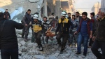 This photo released by the opposition Syrian Civil Defense rescue group, also known as White Helmets, which has been authenticated based on its contents and other AP reporting, shows Civil Defense workers evacuate a victim from site of airstrikes in the village of Balyoun, in Idlib province, Syria, Saturday, Dec. 7, 2019. (Syrian Civil Defense White Helmets via AP)