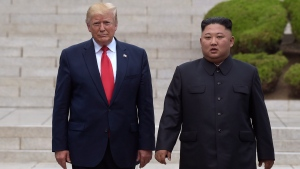 FILE - In this June 30, 2019, file photo, President Donald Trump, left, meets with North Korean leader Kim Jong Un at the North Korean side of the border at the village of Panmunjom in Demilitarized Zone.