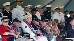 Pearl Harbor survivors and active military members stand on stage during a ceremony to mark the 78th anniversary of the Japanese attack on Pearl Harbor, Saturday, Dec. 7, 2019 at Joint Base Pearl Harbor-Hickam, Hawaii. (AP Photo/Caleb Jones)