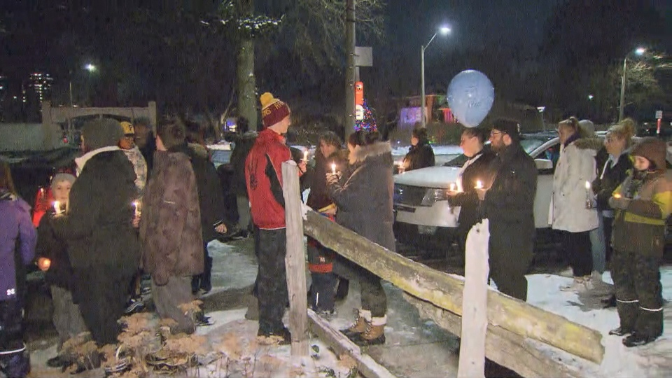 Community members remember the 14-year-old boy who was found dead in a Mississauga laneway a year ago at a memorial on Saturday night. (CP24)