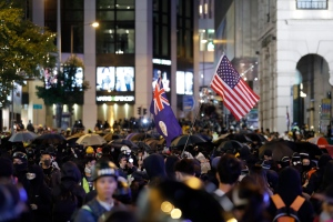 Pro-democracy protesters march into the night in Hong Kong, Sunday, Dec. 8, 2019. Hundreds of thousands thronged Hong Kong streets Sunday, in a mass show of support for a protest movement that shows no signs of flagging as it enters a seventh month. (AP Photo/Dake Kang)