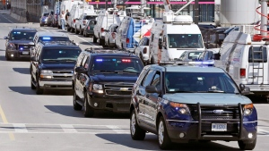 A motorcade carrying Boston Marathon bomber Dzhokhar Tsarnaev passes television trucks while leaving the Moakley Federal Courthouse following the formal sentencing of Tsarnaev in Boston, Wednesday, June 24, 2015. Tsarnaev apologized to the victims and their loved ones for the first time Wednesday just before the judge formally sentenced him to death. (AP Photo/Charles Krupa)