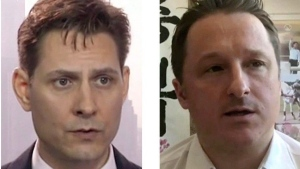 Michael Kovrig (left) and Michael Spavor, the two Canadians detained in China, are shown in these 2018 images taken from video. Canadian prisoner Michael Kovrig is trying to hold on to a sense of humour as he and fellow countryman Michael Spavor approach one year in solitary confinement in China, says Kovrig's current boss. THE CANADIAN PRESS/AP
