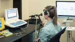 A research trainee is seen during a demonstration of the measurement of blood flow to the brain through transcranial doppler ultrasound at the University of British Columbia's Okanagan campus, in Kelowna, B.C., in an undated handout photo. THE CANADIAN PRESS/HO-UBCO,
