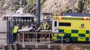 In this image made from video, injured from White Island volcanic eruption are ferried into waiting ambulances in Whakatane, New Zealand, Monday, Dec. 9, 2019. A volcano erupted Monday on a small New Zealand island frequented by tourists, and a number of people were missing and injured after the eruption. (Katee Shanls/NZME via AP)