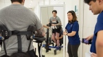 Physiotherapists help Ryan Straschnitzki perform standing exercises following his epidural implant surgery at World Health Hospital in Nonthaburi, Thailand on Friday, December 6, 2019. THE CANADIAN PRESS/Cory Wright