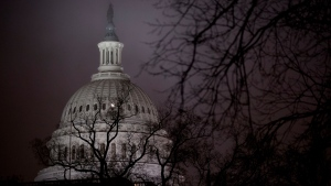 The dome of the U.S. Capitol is visible in the early morning hours as counselors for the Judiciary and Intelligence Committees are set to testify at a hearing before the House Judiciary Committee in the impeachment inquiry of President Donald Trump, on Capitol Hill in Washington, Monday, Dec. 9, 2019. (AP Photo/Andrew Harnik)