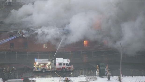 Fire crews are working to contain a large fire that broke out in an industrial building in Schomberg.