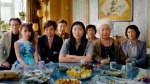 "This image released by A24 shows Awkwafina, center, in a scene from ""The Farewell."" On Monday, Dec. 9, 2019, the film was nominated for a Golden Globe for best motion picture in a foreign language. (A24 via AP)"