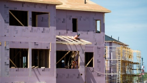 New home construction takes place in a development in Oakville, Ont., on Thursday, August 15, 2019. Canada Mortgage and Housing Corp. says that the pace of housing construction starts increased marginally overall last month compared with October, although there were declines in five provinces. THE CANADIAN PRESS/Nathan Denette