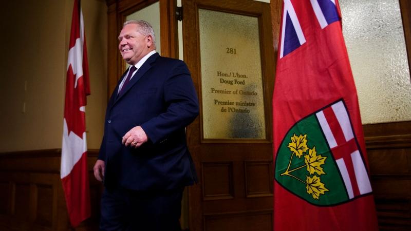Ontario Premier Doug Ford walks to speak with the media at Queen's Park in Toronto on Thursday, November 28, 2019. THE CANADIAN PRESS/Nathan Denette
