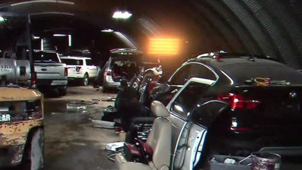 Stolen vehicles and car parts are shown inside an aircraft hangar at Stoney Creek airport in an image released by Hamilton Police Service.