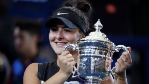 Bianca Andreescu, of Canada, holds up the championship trophy after defeating Serena Williams, of the United States, in the women's singles final of the U.S. Open tennis championships Saturday, Sept. 7, 2019, in New York. Bianca Andreescu delivered a Canadian sporting performance for the ages last summer. The Canadian Davis Cup team nearly provided another last weekend. A remarkable 2019 season will be remembered as the year when everything changed on the Canadian tennis scene. THE CANADIAN PRESS/AP, Adam Hunger