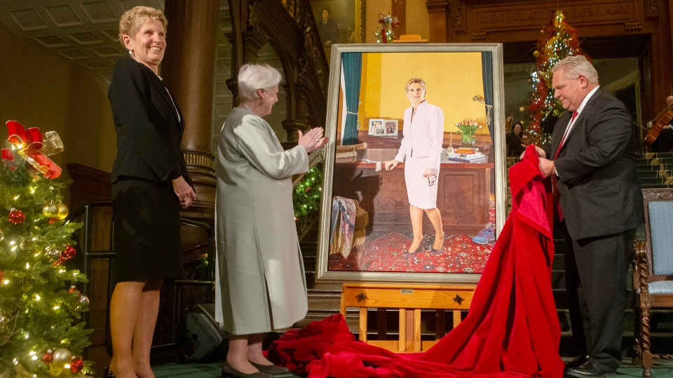 Lt.-Gov. of Ontario Elizabeth Dowdeswell applauds and former Ontario Premier Kathleen Wynne looks to family members as her portrait, painted by Linda Dobbs, is unveiled by Ontario Premier Doug Ford at a ceremony at the Ontario Legislature, in Toronto, Monday, Nov. 9, 2019. THE CANADIAN PRESS/Chris Young