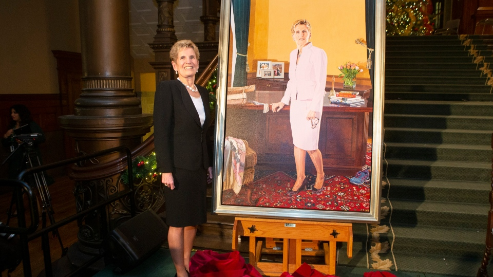 Former Ontario Premier Kathleen Wynne stands beside her portrait, painted by Linda Dobbs, after its unveiling ceremony at the Ontario Legislature, in Toronto, Monday, Nov. 9, 2019. THE CANADIAN PRESS/Chris Young