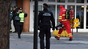 Police personnel and paramedics outside the Ostrava Teaching Hospital after a shooting incident in Ostava, Czech Republic, Tuesday, Dec. 10, 2019. Police and officials say at least four people have been killed in a shooting in a hospital in the eastern Czech Republic. Two others are seriously injured. (Jaroslav Ozana/CTK via AP)