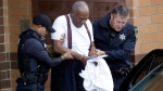 In this Sept. 25, 2018 file photo Bill Cosby is escorted out of the Montgomery County Correctional Facility, in Eagleville, Pa., following his sentencing to three-to-10-year prison sentence for sexual assault.  A Pennsylvania appeals court will hear arguments, Monday, Aug. 12, 2019,  as Cosby appeals his sexual assault conviction.  The 82-year-old Cosby is serving a three- to 10-year prison term.   (AP Photo/Jacqueline Larma, File)