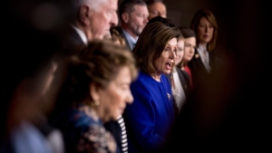 House Speaker Nancy Pelosi of Calif., accompanied by House Congress members, speaks at a news conference to discuss the United States Mexico Canada Agreement (USMCA) trade agreement, Tuesday, Dec. 10, 2019, on Capitol Hill in Washington. (AP Photo/Andrew Harnik)