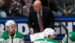 "Dallas Stars coach Jim Montgomery draws up a play during a timeout in the first period of the team's NHL hockey game against the Colorado Avalanche on Friday, Nov. 1, 2019, in Denver. The Stars have fired head coach Montgomery, citing ""unprofessional conduct."" THE CANADIAN PRESS/AP/David Zalubowski"