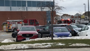 Fire trucks are shown outside Castlebrooke Secondary School after an unknown spray was released in the building's cafeteria. (Ron Dhaliwal)