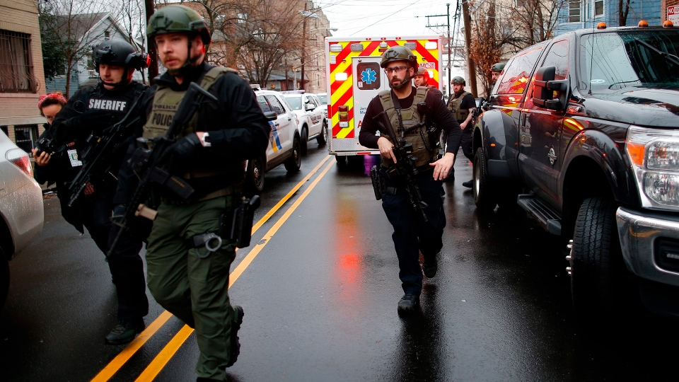Police officers arrive at the scene following reports of gunfire, Tuesday, Dec. 10, 2019, in Jersey City, N.J.  AP Photo/Eduardo Munoz Alvarez)