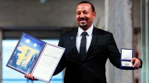Ethiopia's Prime Minister Abiy Ahmed poses for the media after receiving the Nobel Peace Prize during the award ceremony in Oslo City Hall, Norway, Tuesday Dec. 10, 2019. (Håkon Mosvold Larsen/NTB Scanpix via AP)