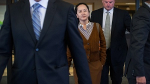 Huawei chief financial officer Meng Wanzhou, who is out on bail and remains under partial house arrest after she was detained last year at the behest of American authorities, leaves B.C. Supreme Court during a lunch break from a hearing, in Vancouver, on Thursday October 3, 2019. THE CANADIAN PRESS/Darryl Dyck