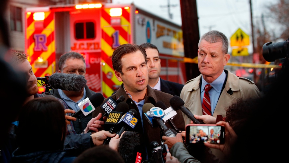 Jersey City, N.J., Mayor Steven Fulop speaks during a press conference at the scene of a shooting, Tuesday, Dec. 10, 2019, in Jersey City, N.J. (AP Photo/Eduardo Munoz Alvarez)
