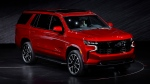 The 2021 Chevrolet Tahoe RST is unveiled in Detroit, Tuesday, Dec. 10, 2019. Global concerns about climate change are not stopping General Motors from making hulking SUVs for U.S. drivers. GM on Tuesday rolled out the next generation of its big truck-based SUVs with more space and features. (AP Photo/Paul Sancya)