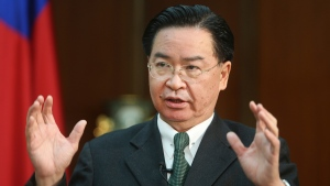 Taiwanese Foreign Minister Joseph Wu speaks during an exclusive interview with The Associated Press at his ministry in Taipei, Taiwan, Tuesday, Dec. 10, 2019. Wu was careful to say his government has no desire to intervene in Hong Kong's internal affairs, and that existing legislation is sufficient to deal with a relatively small number of Hong Kong students or others who seek to reside in Taiwan. (AP Photo/Chiang Ying-ying)