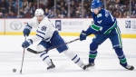 Toronto Maple Leafs' John Tavares (91) skates with the puck in front of Vancouver Canucks' Elias Pettersson (40), of Sweden, during the third period of an NHL hockey game in Vancouver, on Tuesday December 10, 2019. THE CANADIAN PRESS/Darryl Dyck