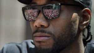 Cheering fans are reflected in the sunglasses of Toronto Raptors' Kawhi Leonard during the 2019 Toronto Raptors Championship parade in Toronto on Monday, June 17, 2019. THE CANADIAN PRESS/Frank Gunn