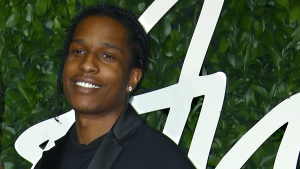 In this file photo dated Monday, Dec. 2, 2019, ASAP Rocky poses for photographers upon arrival at the British Fashion Awards in central London. (FILE Photo by Joel C Ryan/Invision/AP)