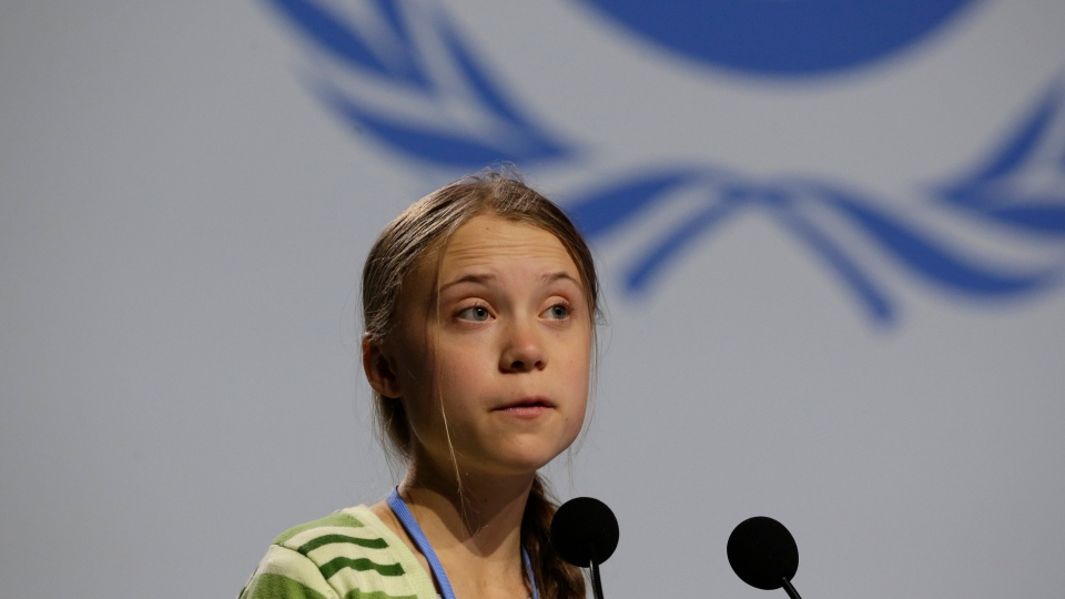 Swedish climate activist Greta Thunberg addresses a plenary of U.N. climate conference at the COP25 summit in Madrid, Spain, Wednesday, Dec. 11, 2019. Thunberg is in Madrid where a global U.N.-sponsored climate change conference is taking place. (AP Photo/Paul White)