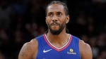 Los Angeles Clippers forward Kawhi Leonard walks upcourt during the second half of an NBA basketball game against the San Antonio Spurs, Friday, Nov. 29, 2019, in San Antonio. (AP Photo/Darren Abate)
