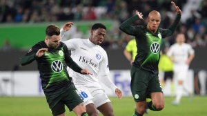 Wolfsburg's Renato Steffen, left, and Marcel Tisserand, battle for the ball with Gent's Jonathan David during the Europa League Group I soccer match between Vfl Wolfsburg and KAA Genk in Wolfsburg, Germany, Thursday, Nov. 7, 2019. Teenage forward Jonathan David, who has scored a Canadian-record 28 goals for club and country this year, has been named Canadian Player of the Year. THE CANADIAN PRESS/Peter Steffen/dpa via AP